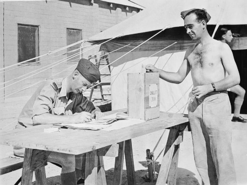 Leading_Aircraftman_McLeash_votes_in_North_Africa_1945_IWM_CM_6285