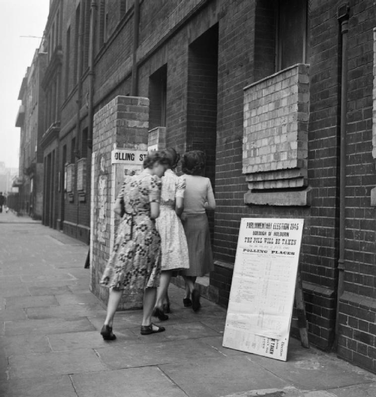 Voters_arriving_at_a_polling_station_in_the_Italian_Hospital_Queen_Square_Holborn_London_to_cast_their_vote_in_the_General_Election_of_1945._D25102